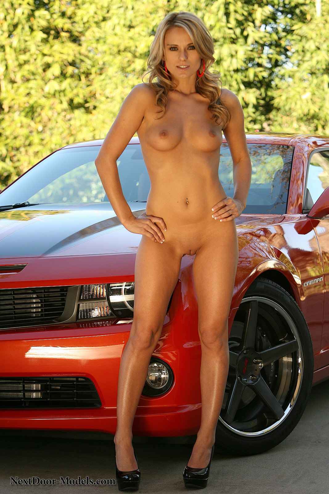 Nude model on car